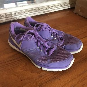 Purple Nike athletic shoes